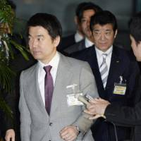 Constitutional cooperation?: Nippon Ishin no Kai (Japan Restoration Party) leaders from Osaka, Toru Hashimoto (left) and Ichiro Matsui, leave the prime minister's office Tuesday evening after meeting with Prime Minister Shinzo Abe. | KYODO