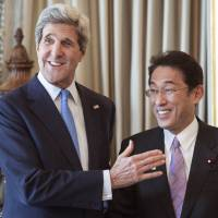 Huddle: U.S. Secretary of State John Kerry greets Foreign Minister Fumio Kishida ahead of their Wednesday meeting in London on the eve of the G-8 Foreign Ministers meeting.   POOL