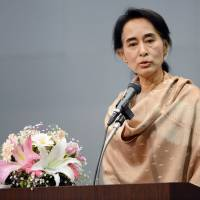 Suu Kyi arrives in Japan for first visit in 27 years