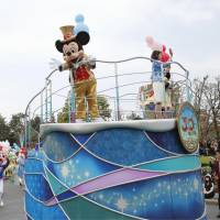 Going strong at 30: Visitors watch a parade celebrating the 30th anniversary of Tokyo Disneyland's opening on Monday in Urayasu, Chiba Prefecture. | KYODO