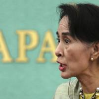 Face of democracy: Myanmar opposition leader Aung San Suu Kyi holds a press conference Wednesday in Tokyo. | AP