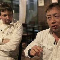 Born to be mild: Film director Jamie Morris (left) and former 'bōsōzoku biker gang leader Kazuhiro Hazuki talk about the documentary 'Sayonara Speed Tribes' after it was screened in Tokyo on April 12. | COURTESY OF HEATH COZENS