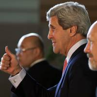 Confident: U.S. Secretary of State John Kerry gestures after meeting Monday with Prime Minister Shinzo Abe in Tokyo. | AP