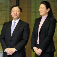 Overseas assignment: Crown Princess Masako greets her husband, Crown Prince Naruhito, upon his return from New York at their residence in Togu Palace, Tokyo, in March. | KYODO