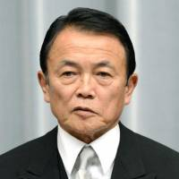 No fear: Deputy Prime Minister Taro Aso (left) and Keiji Furuya, state minister in charge of the abduction issue, visited controversial Yasukuni Shrine in Tokyo on Sunday. | KYODO