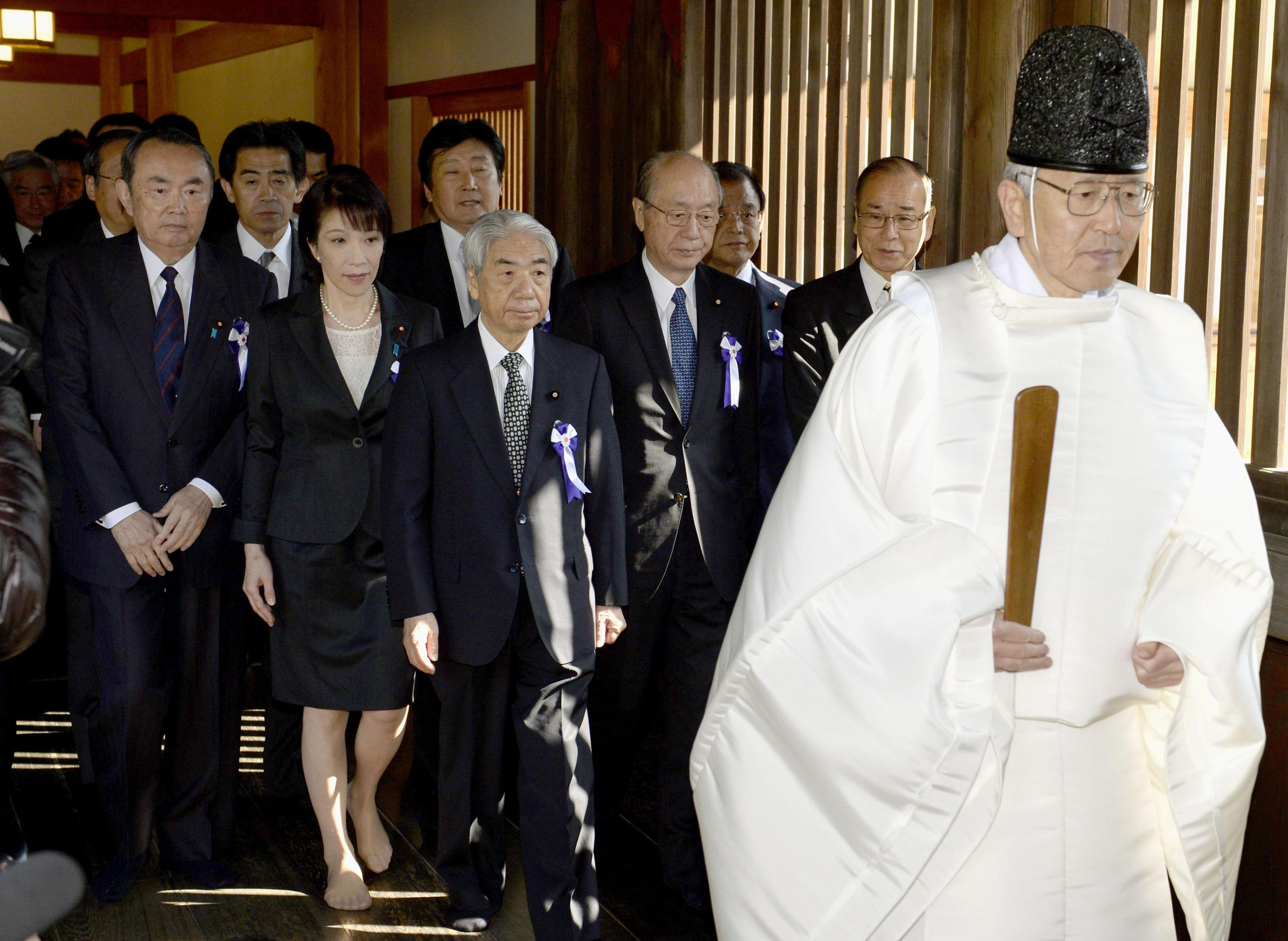 Contentious visit: A group of Diet members visit Yasukuni Shrine in Tokyo on Tuesday morning.   KYODO