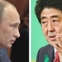 Head to head: Russian President Vladimir Putin attends a meeting during a trip to Elista in the southern Kalmykia region on April 16, while Prime Minister Shinzo Abe answers questions at a news conference April 19 at the Japan National Press Club in Tokyo. | AFP-JIJI