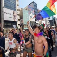 Out and about: Lesbian, gay, bisexual and transgender people and their supporters take part in the 'Tokyo Rainbow Pride' parade in Shibuya Ward's posh Harajuku shopping district on Sunday. | AFP-JIJI
