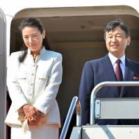 Up and away: Crown Princess Masako and Crown Prince Naruhito acknowledge the crowd before boarding a plane for the Netherlands at Tokyo's Haneda airport on Sunday. The Crown Princess, who has been suffering from a mysterious stress-induced illness for more than a decade, is taking her first official overseas trip in 11 years. | AFP-JIJI