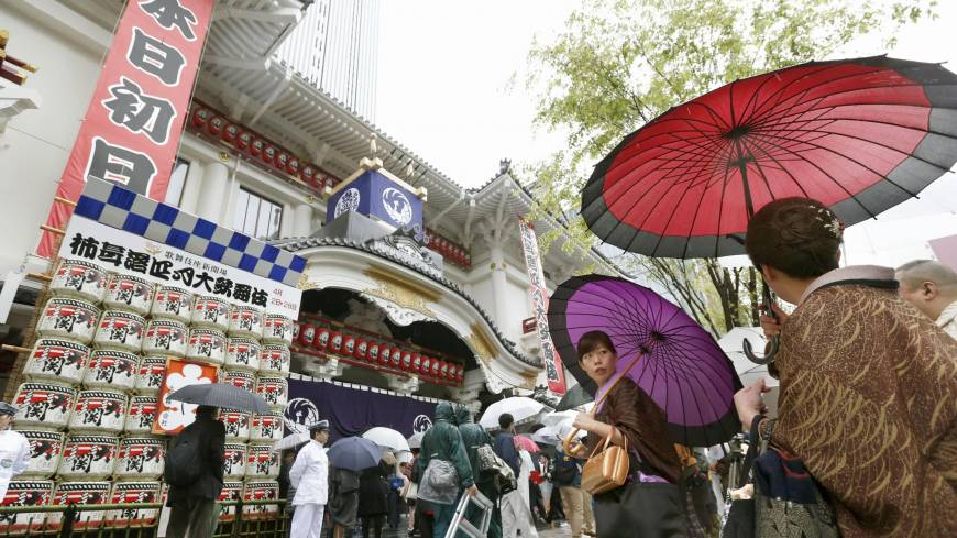 The show goes on: People wait to enter Tokyo's rebuilt Kabukiza theater Tuesday, when it reopened after a three-year hiatus.  | KYODO