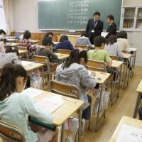 Skills check: Students take the national achievement examination at an elementary school in Tokyo on Wednesday.   | KYODO