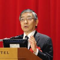 The governor's not for turning: Bank of Japan Gov. Haruhiko Kuroda delivers a speech in Chiyoda Ward, Tokyo, on Friday. | KYODO
