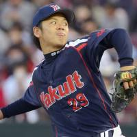 A first for everything: Swallows right-hander Yasuhiro Ogawa picks up a victory in his Nippon Professional Baseball debut on Tuesday against the Carp. Tokyo Yakult defeated Hiroshima 6-2 at Mazda Stadium. | KYODO
