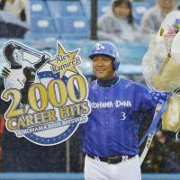 A long time coming: Yokohama BayStars slugger Alex Ramirez receives special recognition after collecting his 2,000th hit in Nippon Professional Baseball on Saturday at Jingu Stadum. | KYODO