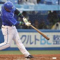Milestone hit: Yokohama's Alex Ramirez belts a sixth-inning home run, the 2,000th of his Nippon Professional Baseball career, in the BayStars' 6-3 win over the Tokyo Yakult Swallows on Saturday at Jingu Stadium. | KYODO