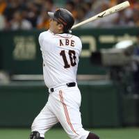 Back in the groove: Yomiuri's Shinnosuke Abe hits a three-run home run in the fifth inning of the Giants' 8-6 win over the Dragons at Tokyo Dome on Sunday. | KYODO