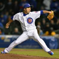 Cubs win, Cubs win: Closer Kyuji Fujikawa pitches against the Brewers on Tuesday in Chicago. The Cubs won 6-3. | AP