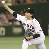 The right stuff: Yomiuri Giants pitcher Tomoyuki Sugano issues zero walks in eight innings on Saturday at Tokyo Dome. Sugano struck out 10 in the Giants' 3-1 win over the Tokyo Yakult Swallows. | KYODO