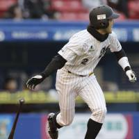 Pleasing the locals: The Marines' Shunichi Nemoto hits a go-ahead single in the seventh inning against the Eagles on Saturday at Chiba Lotte Stadium. Chiba Lotte defeated Tohoku Rakuten 6-3. | KYODO