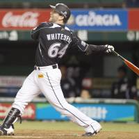Highlight man: The Marines' Josh Whitesell belts a go-ahead home run in the ninth inning against the Lions on Thursday at Seibu Dome. Chiba Lotte edged Seibu 5-4. | KYODO