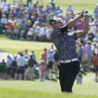 Ryo Ishikawa takes a swing on the Masters course Saturday en route to his 4-over 76 in the third round.   KYODO
