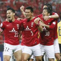 Not done yet: Urawa Reds players react during their victory over China's Guangzhou on Wednesday.   KYODO