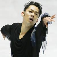 Take one for the team: Daisuke Takahashi performs during the World Team Trophy on Thursday. | KYODO