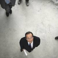 Eye on transparency: Francois Hollande campaigns for the Socialist Party's primary elections in May 2011 in Dijon, France. Under a new transparency policy, Hollande on Monday released details about the personal wealth of all 38 members of his government. | AFP-JIJI