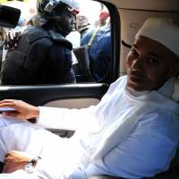 Rising son: Karim Wade, son of Senegal's former president, arrives at the top anticorruption prosecutor's office in Dakar last month to defend himself against 'illegal wealth' accusations. | AFP-JIJI
