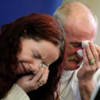 'Harrowing' case: Mick Philpott and his wife, Mairead, weep during a news conference on May 16, 2012, in Derby, England, following a fire at their home that claimed the lives of six of their children. | AP