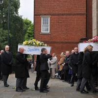 Blazing anger: Coffins holding the bodies of six children who died in a house fire deliberately planned and set by their parents, are carried into St. Mary's Church in Derby, central England, for a funeral service on June 22, 2012. | AFP-JIJI