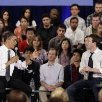 Political ambitions: U.S. President Barack Obama and Facebook CEO Mark Zuckerberg discuss the national debt at a townhall meeting on April 20, 2011. | AP