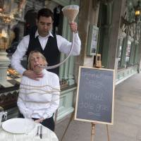 Force-fed: PETA's Ingrid Newkirk, with a funnel of feed in her mouth, protests the sale of foie gras in London last month. | AP