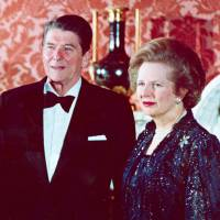 Dignitaries: British Prime Minister Margaret Thatcher (right) attends a formal dinner at Buckingham Palace, London, with (from left) German Chancellor Helmut Kohl, Queen Elizabeth II and U.S. President Ronald Reagan in June 1984. | AP