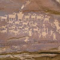 Invisible biological world?: A hunting scene cut into desert varnish by Native Americans in Utah's Nine Mile Canyon. How desert varnish forms has yet to be resolved despite intense research by geologists — a situation that has led some scientists to suspect that it could be the manifestation of an alternative, invisible biological world that they call the shadow biosphere. | SCOTT CATRON