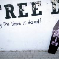 Grave memories: A mock coffin of former British Prime Minister Margaret Thatcher rests against graffiti in the Bogside area of Londonderry, Northern Ireland, Wednesday, the day of her funeral. Thatcher was hated by Irish republicans. | AP