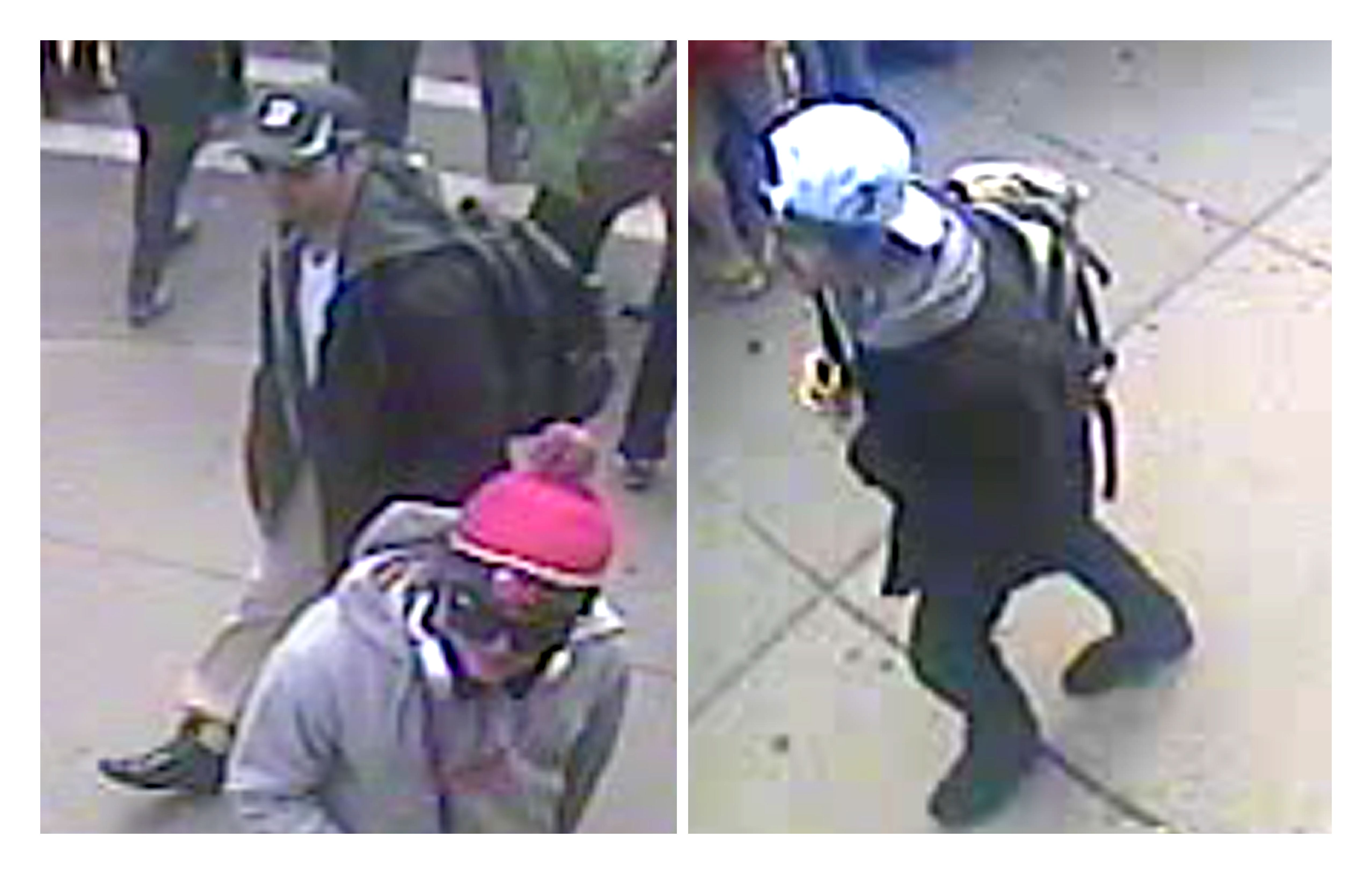 Caught on film: These video stills released Thursday by the FBI show the two Boston bombing suspects, one in a black baseball cap and the other in a white cap, walking along the route of the marathon Monday. Investigators consider the two men to be 'armed and extremely dangerous,' said Rick DesLauriers, FBI chief in Boston. The bureau has no details yet of the suspects' identities, origin or motive. | AFP-JIJI