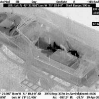 No place to hide: A thermal image shows Boston bombing suspect Dzhokhar Tsarnaev hiding inside a boat as police searched for him in Watertown, Massachusetts, on Friday. | AP
