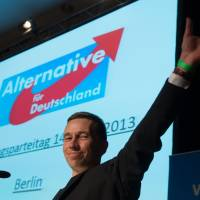 Making his mark: Alternative for Germany cofounder Bernd Lucke waves to supporters at the political party's first meeting in Berlin on April 14. | AFP-JIJI