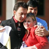 Freed: Paul Kevin Curtis, who had been in custody under suspicion of sending ricin-laced letters to President Barack Obama and others, hugs his attorney, Christi McCoy, following his release Tuesday in Oxford, Mississippi. | AP