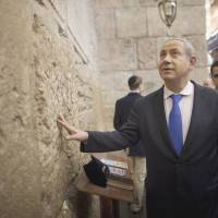 Un-Orthodox ruling: Israeli Prime Minister Benjamin Netanyahu touches the stones of the Western Wall in Jerusalem on election day in January. | AP