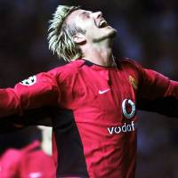 Amazing feeling: David Beckham celebrates his goal against Zalaegerszeg of Hungary with teammate Philip Neville during Manchester United's  UEFA Champions League qualifying match Aug. 27, 2002, in Manchester, England.   | AP