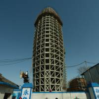 Alpha male: The headquarters of the People's Daily, the Communist Party's mouthpiece, is seen under construction in March. | AFP-JIJI