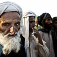 On the margins: Members of the Baloch Bugti tribe who were evicted from their villages during the regime of former military ruler Pervez Musharraf rally Monday in Islamabad to demand a return to their towns and take part in Pakistan's May 11 election. | AP