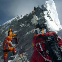 The only way is up: Alpinists climb past 'Hillary Step' as they head for the summit of Mount Everest. It will be 60 years ago Wednesday that New Zealander Edmund Hillary and Tenzing Norgay of Nepal conquered the 8,848-meter-high mountain. | AFP-JIJI