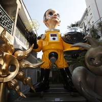 Bright kid: Kenji Yanobe's 'Sun Child,' dressed in a hazmat suit, looks into the distance from the garden of the Taro Okamoto Memorial Museum in Tokyo's Minami Aoyama district. | TARO OKAMOTO MEMORIAL MUSEUM