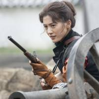 Hot shot: In this year's taiga drama, actress Haruka Ayase plays the gun-slinging Yae Niijima (left), who reinvented herself as a paragon of modernity after she and her native domain of Aizu suffered a crushing defeat in the Boshin War of 1868-69. | NHK