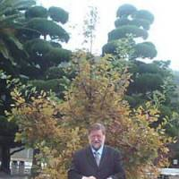 Lasting bond: Yours truly standing, this year, before an English oak I helped ceremonially plant at the MSDF College in Etajima, Hiroshima Prefecture, in 2002. | C.W. NICOL PHOTOS