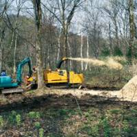 A chipper at work on trimmings in our woods. | C.W. NICOL PHOTO