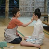 No woman is an island: Usually-absent mother Akemi (Shinobu Otake, left) gives her daughter Yuna (Ayaka Miyoshi) some rare attention in 'Tabidachi no Shima Uta — Jugo no Haru (Leaving on the 15th Spring).' | © 2012 'Tabidachi no Shimauta' Seisaku Iinkai